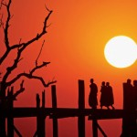 Young monks in Amarapura, Myanmar (formally Burma), walking across the ''U Bein Bridge'' at sunset. This is the longest teak bridge in the world (http://en.wikipedia.org/wiki/Amarapura). Nikon D200, AF VR Zoom-Nikkor 80-400mm f/4.5-5.6D ED, @400mm, ISO- 100, f/13, 1/640, AWB, Pattern metering, Auto focus. Shot without filtration, handheld, from a small boat. No post-processing, no crop. Untouched file that came out the camera.