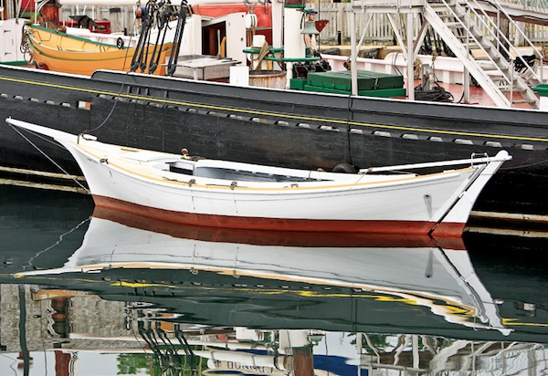 Eli Amon - Gearing up for Photo Adventures - Reflected Boat